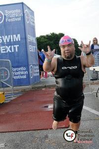 Image of John Young exiting the swim at a triathlon.